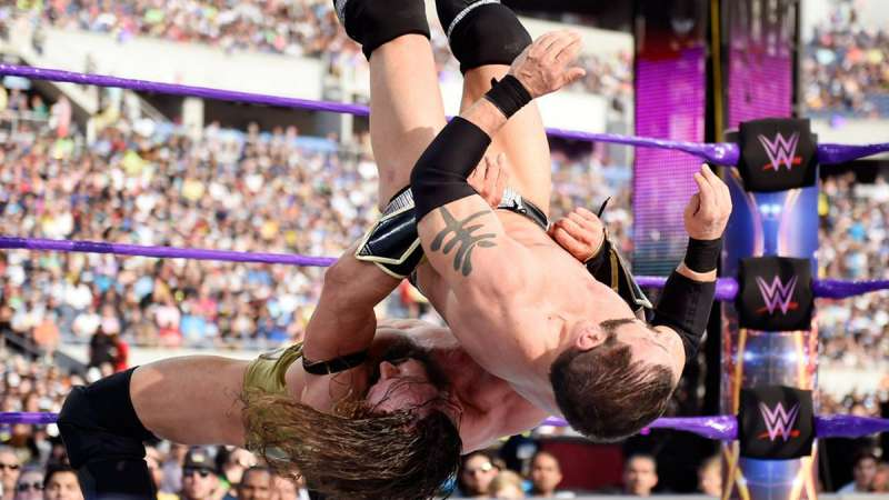 Neville suplexes Austin Aries at WWE WrestleMania 33 in the Cruiserweight Championship Match