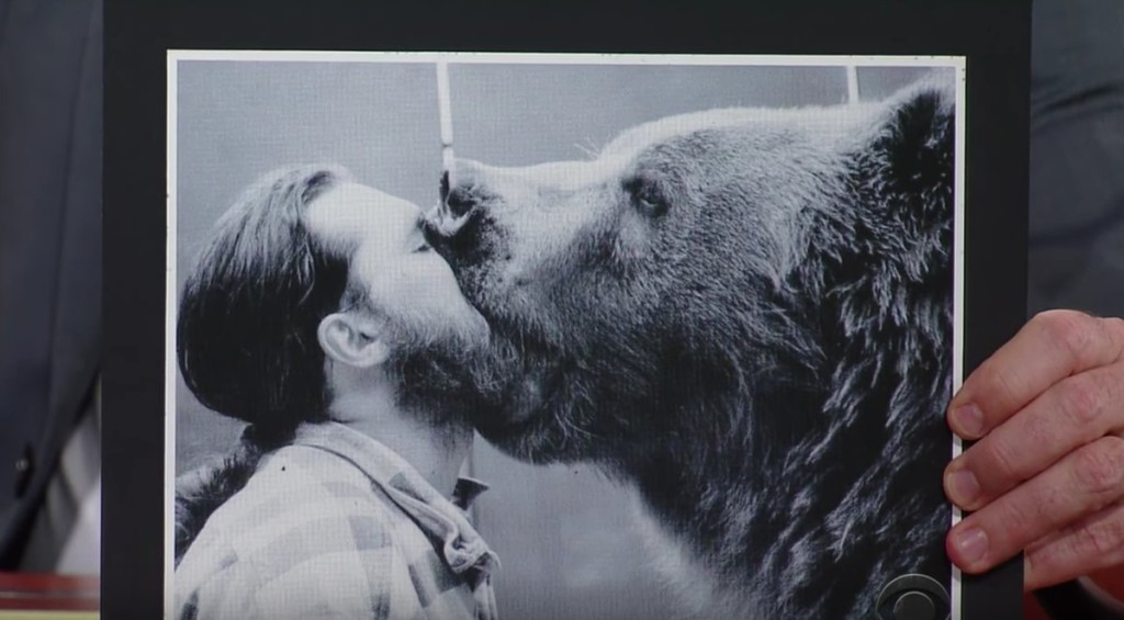 Jeff Watson, professional bear wrangler, lets a bear gnaw on his face