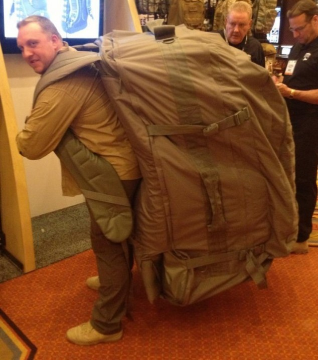 The soldier with a very, very large backpack