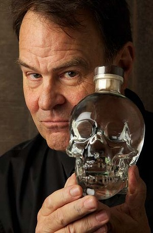 Dan Aykroyd poses with his weird drink in a skull-shaped bottle