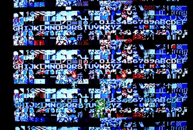 An NES game has trouble booting up, resulting in a screen full of garbled pixels