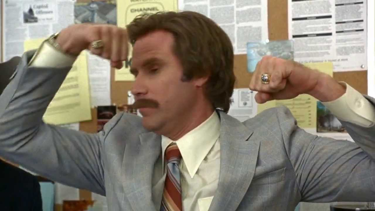 Will Ferrell as Ron Burgundy, showing off his guns