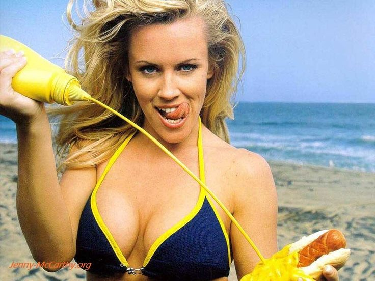 Jenny McCarthy squirts mustard suggestively on a hotdog