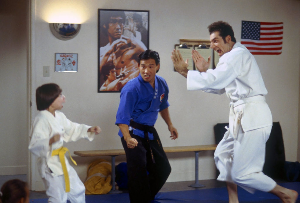 Kramer fights children in his karate class on Seinfeld