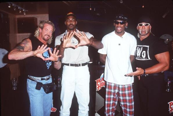 Diamond Dallas Page, Karl Malone, Dennis Rodman, and Hollywood Hulk Hogan pose for the camera