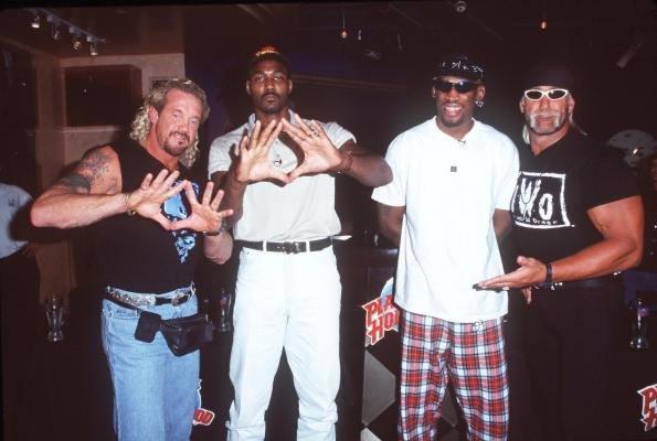 Diamond Dallas Page, Karl Malone, Dennis Rodman, and Hollywood Hulk Hogan pose for the camera