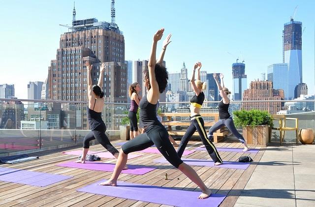 Women doing rooftop yoga