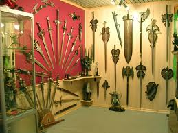 A room full of swords and other implements of battle and war