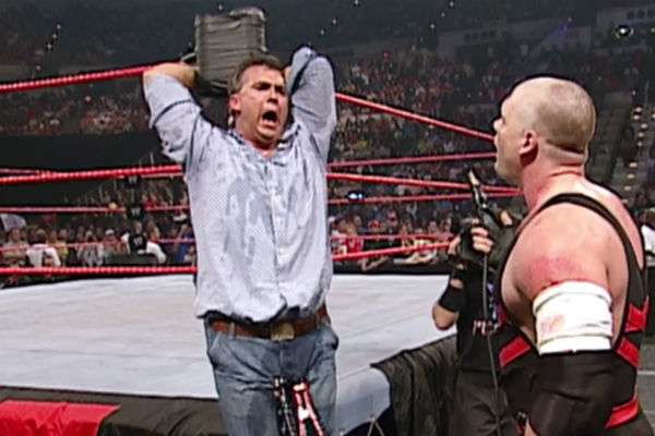 Kane attaches jumper cables to Shane McMahon's grapefruits